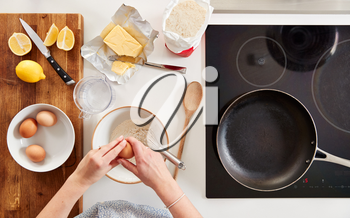 Overhead Shot Of Woman In Kitchen With Ingredients Making Pancakes Or Crepes For Pancake Day