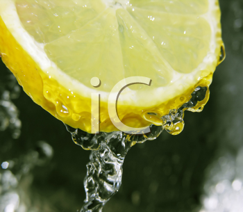 Water dripping off a lemon slice