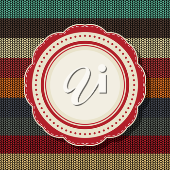 Royalty Free Clipart Image of a Vintage Label on a Striped Knitted Background