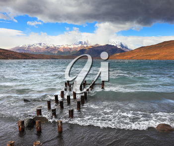 Boat dock on the lake. Storm clouds, wind and waves at the Laguna Azul. National Park Torres del Paine in Patagonia, Chile