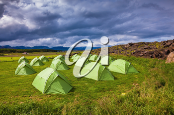 Summer holidays in Iceland. Scenic camp on a green meadow