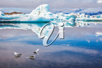 Ice splendor. Floating ice and clouds reflected in the mirror-smooth water Ice Lagoon, Iceland