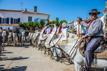 Sent-Mari-de-la-Mer, Provence, France - May 25, 2015.  Convoy - guards on white horses lined up before the start of parade. Square in the center of city. World Festival of Gypsies