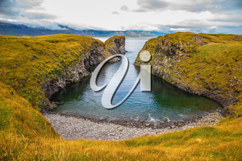 The picturesque coastal bay near the fishing village of Arnastapi. Iceland in July