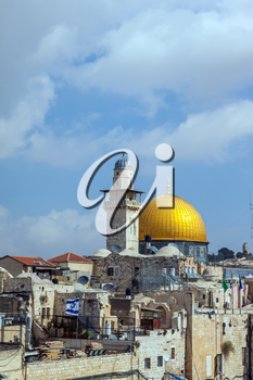 Jerusalem, Israel. Mosque Golden dome of the Qubbat al-Sakhra and roofs of old houses with the flag of Israel