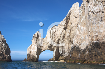Royalty Free Photo of a Natural Arch Over the Ocean