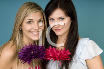 Royalty Free Photo of Two Women Holding Flowers