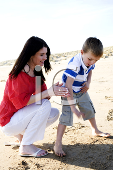 Royalty Free Photo of a Mother and Son Playing on the Beach
