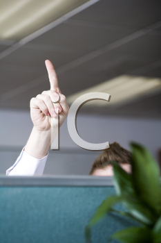 Royalty Free Photo of a Man Pointing One Finger Towards the Ceiling