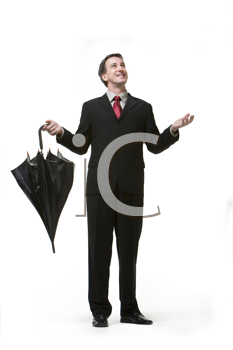 Royalty Free Photo of a Man in a Business Suit Checking for Rain