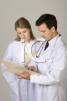 Royalty Free Photo of a Male and Female Doctor Looking at a Chart