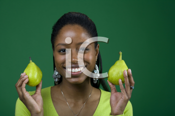 Royalty Free Photo of a Black Woman Holding Two Pears
