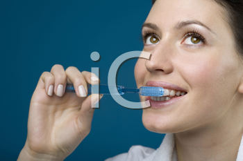 Royalty Free Photo of a Woman Brushing Her Teeth