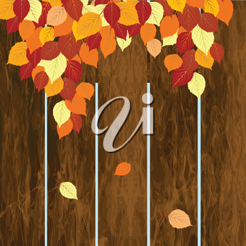 Autumn background with wooden fence and leaves