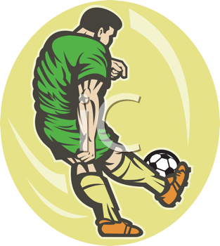 Royalty Free Photo of a Soccer Player Kicking the Ball