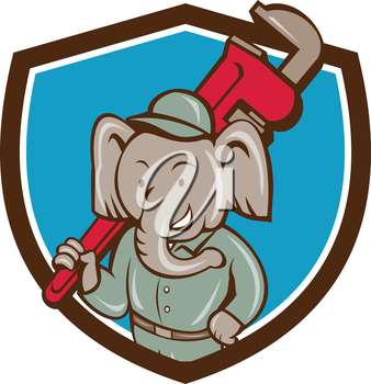 Illustration of an african elephant plumber mascot holding monkey wrench on shoulder set inside shield crest on isolated background done in cartoon style.