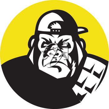 Illustration of an angry gorilla ape head wearing baseball cap viewed from front set inside circle on isolated background done in retro style.