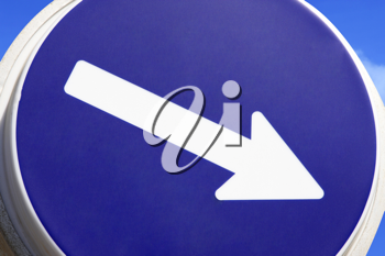 Close up of a road sign with arrow pointing right