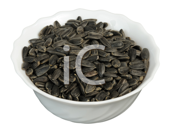 Sunflower seeds in a plate on white background, isolated