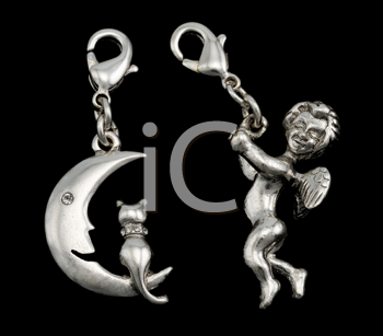 Royalty Free Photo of Cat and Moon Pendant and a Cupid Pendant