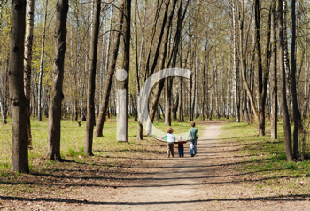 Royalty Free Photo of Children Walking in a Park