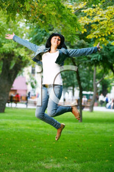 Royalty Free Photo of a woman jumping into the air.