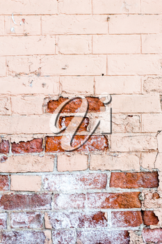 Vertical old red brick wall texture half painted.