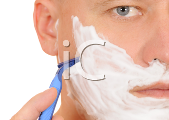 Royalty Free Photo of a Man Shaving