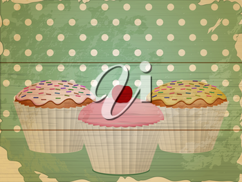 retro cupcakes on wooden background