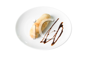 sweet bun with chocolate at plate isolated on a white