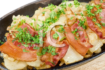 Royalty Free Photo of Fried Potatoes With Bacon and Vegetables