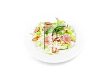 Tasty salad dish close up with chicken and vegetables on a white background