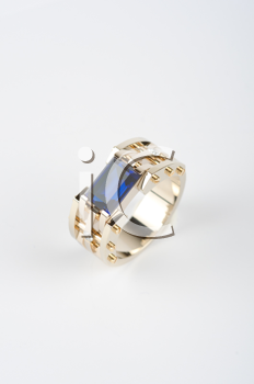 gold ring with big blue gem and smaller diamonds