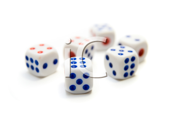 close up of blue and red dice on white background