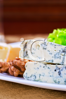 cheese with lettuce, grapes and nuts closeup