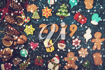 Gingerbreads cookies for new 2019 year holiday on wooden background, xmas theme