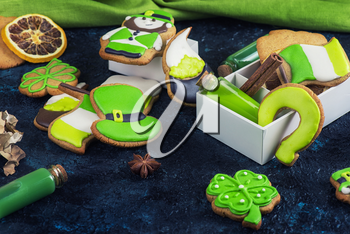 Gingerbreads cookies for Patrick's day on dark stone background