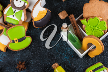 Homemade cookies for Patrick's day on dark concrete background