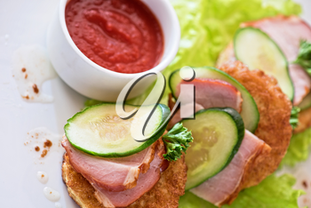 pancakes with ham and cucumber with tomato sauce and lettuce