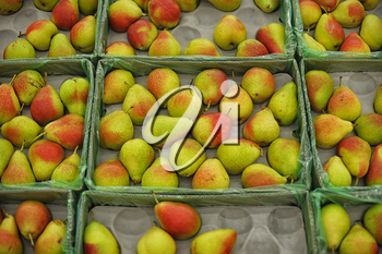 background of ripe juicy pears in market