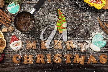 Gingerbreads and coffee for new years and christmas on wooden background, xmas theme