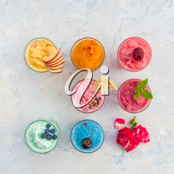 Different smoothie set on a white concrete background