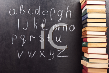 Royalty Free Photo of the Alphabet on a Chalkboard With Books