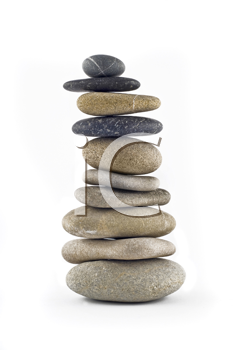 Balanced stone stack or tower isolated over white background