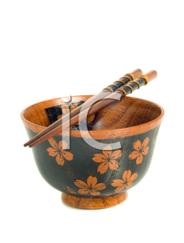 Japanese tableware. Chopsticks and a bowl isolated on white