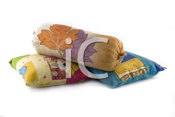 Pile of three colorful pillows over white background