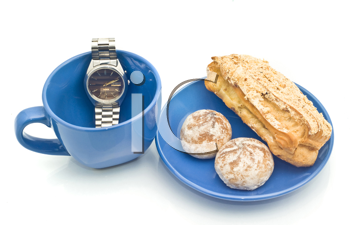 Waiting for Lunch time - Watch, empty blue cup and delicious pastry