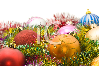 Xmas greetings - colorful decoration balls and tinsel and over white