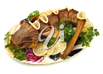 Bloated sheatfish with lemon and parsley on the plate over white