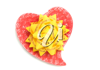 Love - yellow bow on red heart over white background